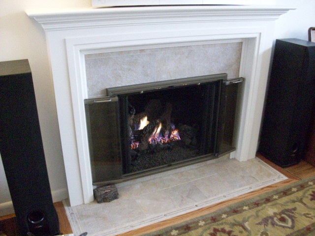 New Wall, Custom Painted Mantel, New Stone Tile Hearth and Surround, Clearview Champagne Nickle Full Swing Doors and Oak Floor Moulding