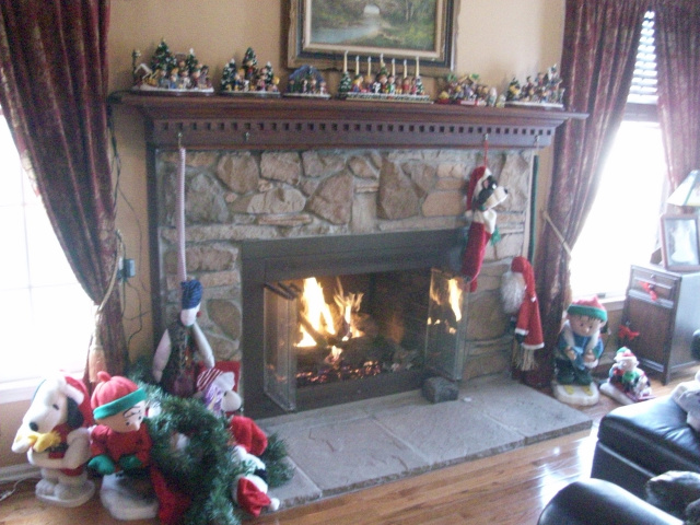 Gas Log Conversion, New Hearth Stones, Refinished Glass Doors, Cultured Stone, Reconditioned Mantel
