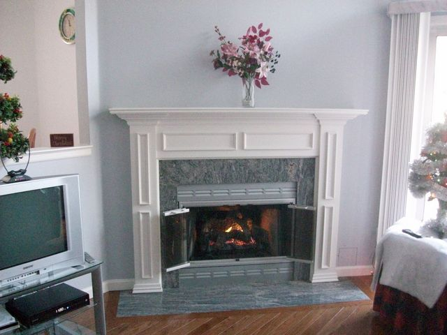 Gas Log Conversion, Refinished Grill Work, Granite Hearth & Surround, Custom White Mantel