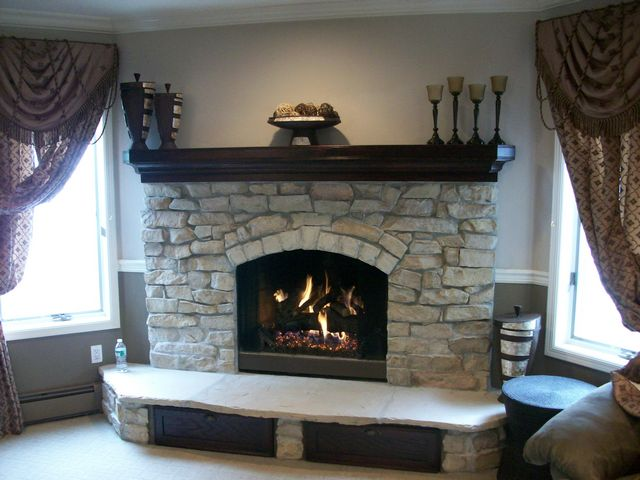 Real Quarry Stone, Arizona Stone Hearth, Gas Logs, Custom Oak Mantel and Custom pull out drawers under hearth.